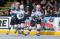 KELOWNA, CANADA - FEBRUARY 10: Carsen Twarynski #18, Nolan Foote #29 and Lucas Johansen #7 of the Kelowna Rockets skate to the bench to celebrate a goal against the Vancouver Giants on February 10, 2017 at Prospera Place in Kelowna, British Columbia, Canada.  (Photo by Marissa Baecker/Shoot the Breeze)  *** Local Caption ***