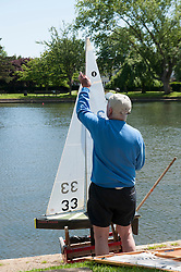 (c) Licensed to London News Pictures. 06/06/2014 Essex, UK. A group of men sail their radio controlled yachts on a lake in Southchurch Park, Southend. Making the most of the warm sun and sea breeze to enjoy their hooby.  Photo credit Simon Ford/LNP