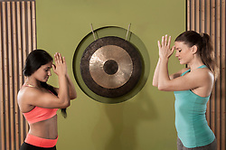 Two women practicing yoga pose fitness