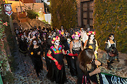 Students dressed as La Calavera Catrina for Day of the Dead festival parade through the historic district in San Miguel de Allende, Guanajuato, Mexico. The week-long celebration is a time when Mexicans welcome the dead back to earth for a visit and celebrate life.