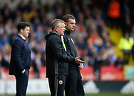 Chris Wilder manager of Sheffield Utd talks to the fourth official Joe Hull during the English League One match at  Bramall Lane Stadium, Sheffield. Picture date: April 30th 2017. Pic credit should read: Simon Bellis/Sportimage