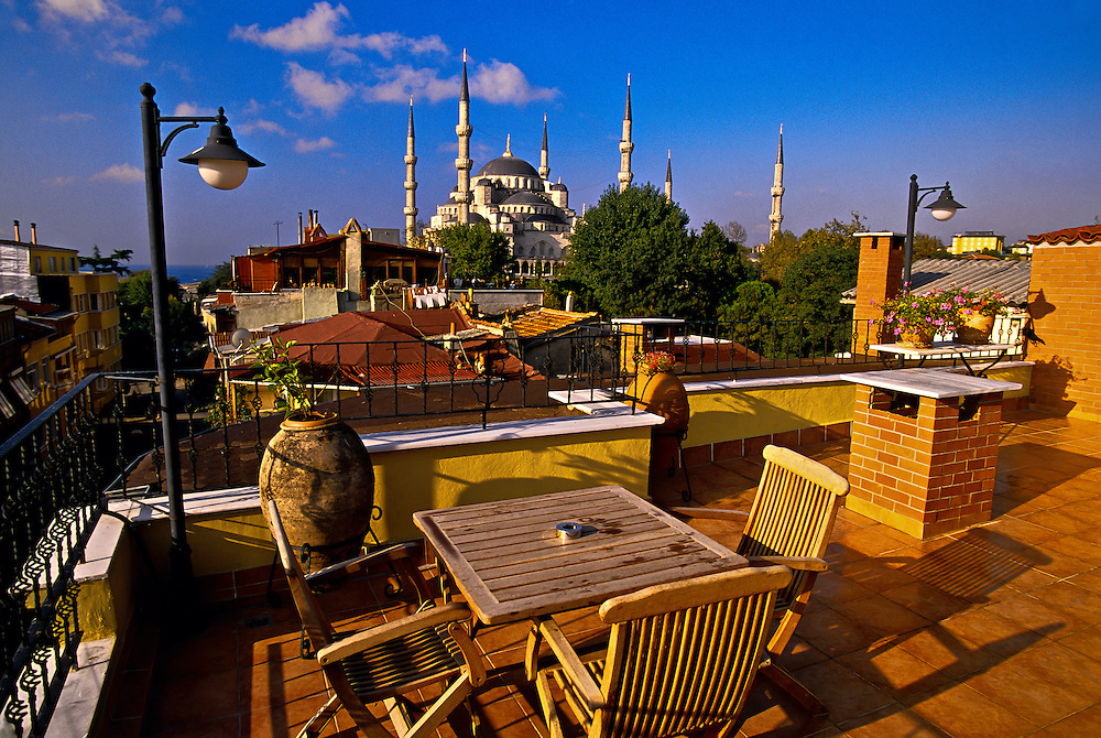 Roof terrace of Hotel Uyan with the Blue Mosque behind, Sultanahmet, Istanbul, Turkey
