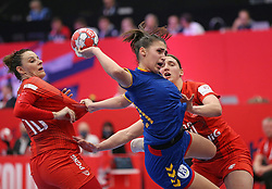 KOLDING, DENMARK - DECEMBER 5: Lorena Ostase shoots as she is challenged by Marta Gega (L) and Joanna Drabik (R)during the EHF Euro 2020 Group D match between Poland and Romania in Sydbank Arena, Kolding, Denmark on December 5, 2020. Photo Credit: Allan Jensen/EVENTMEDIA.