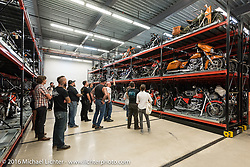 Checking out bikes behind the scenes on the archive's large moving racks while on a tour of the Harley-Davidson Museum during the Milwaukee Rally. Milwaukee, WI, USA. Saturday, September 3, 2016. Photography ©2016 Michael Lichter.