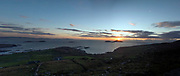 The sun sets over Scarriff Island and Derrynane Bay in County Kerry, Ireland.<br /> Photo Don MacMonagle