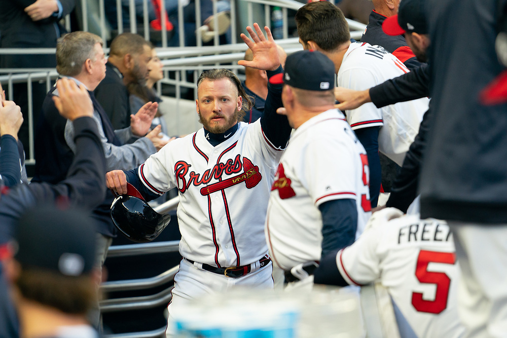 Josh Donaldson celebrates scoring during the home opener against the Chicago Cubs on Monday, April 1, 2019. The Braves won 8-0. Photo by Kevin D. Liles/Atlanta Braves
