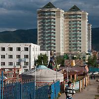 Traditional nomadic ger & modern high-rise buildings in Ulaanbaator, Mongolia