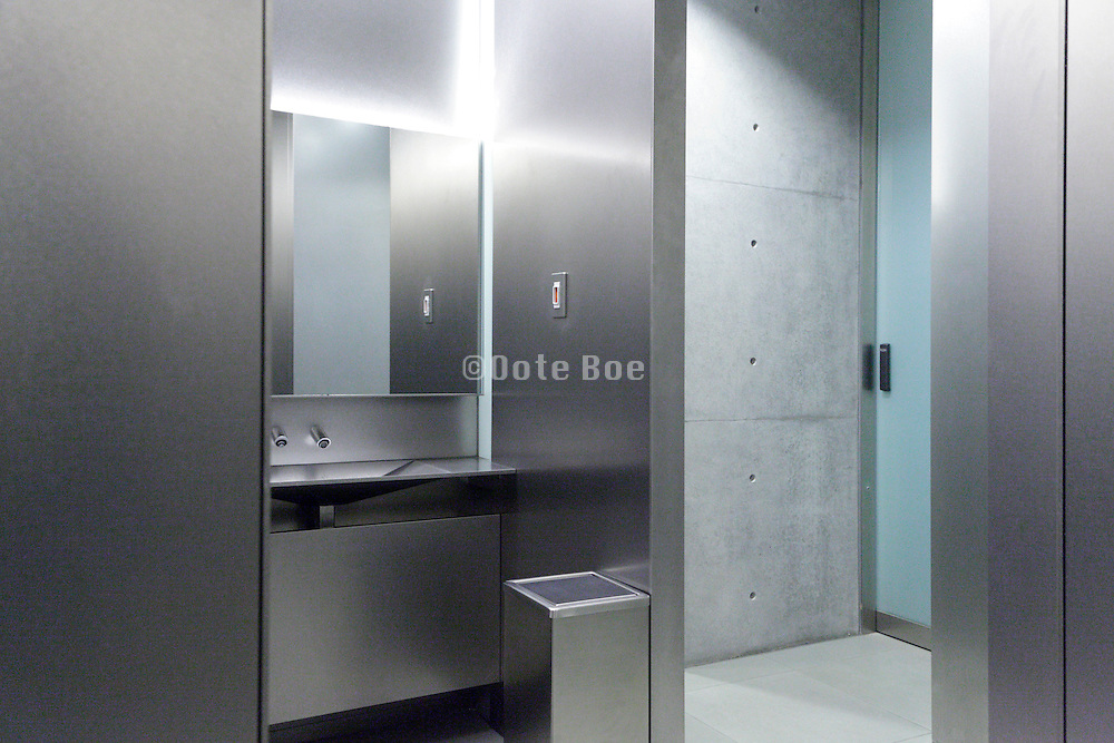 the men toilet room inside the 21-21 design building by architect Tadao Ando