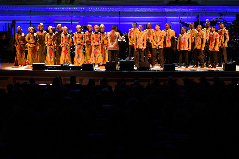 """Photos of the Choir of the Kimbanguist Symphony Orchestra performing live for the """"It Always Seems Impossible Until It Is Done"""" World AIDS Day event at Carnegie Hall in New York, NY on December 1, 2015. © Matthew Eisman/ Rolling Stone. All Rights Reserved"""