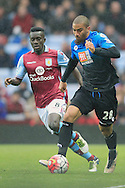 Lewis Grabban of Bournemouth (R) in action with Idrissa Gana of Aston Villa.<br /> Barclays Premier League match, Aston Villa v AFC Bournemouth at Villa Park in Birmingham, The Midlands on Saturday 09th April 2016.<br /> Pic by Ian Smith, Andrew Orchard Sports Photography.