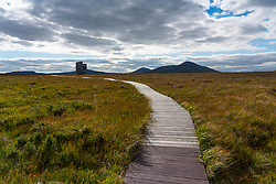 View of visitor viewing tower on landscape of the Flow Country at RSPB Forsinard Flows Nature Reserve in Sutherland, Scotland, UK