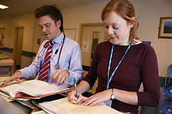 Clinical Pharmacist and Senior House Officer in consultation,