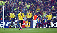 Photo: Chris Ratcliffe.<br /> Arsenal v Barcelona. UEFA Champions League Final. 17/05/2006.<br /> Gutted Arsenal players as Barcelona celebrate in the background.