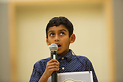 Jibril Asif Moinuddin looks to the ceiling while spelling a word during the 2016 Milpitas Youth Spelling Bee at the Milpitas Senior Center in Milpitas, California, on January 22, 2016. (Stan Olszewski/SOSKIphoto)
