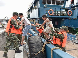 July 29, 2017 - Policemen evacuate people in the fishing port before the typhoon Nesat, the ninth typhoon this year,  arrives in Shishi City of southeast China's Fujian Province. Fujian meteorological station said the 10th typhoon had been also formed and was expected to land late Sunday or early next Monday in central to northern Fujian. (Credit Image: © Song Weiwei/Xinhua via ZUMA Wire)