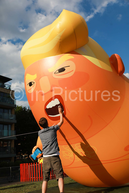 The inflatable Trump Baby is tested, cleaned  and presented to the media, May 22nd 2019, North London, United Kingdom. The Trump Baby last flew over Parliament Square when the US President Trump last visited the United Kingdom in 2017 causing great controversy. The team behind the Trump Baby say they are making the necessary preparations to fly the balloon again in London - but insist that they want their intervention to help focus attention and financial support on what they say are the 'groups across North America and the UK which have been pushing back against the politics of hate and division that are represented by Trump.' The organisers say that the Trump Baby balloon will only fly if a public fundraising target of £30,000 is raised by 3rd June - the day Trump arrives in the UK.