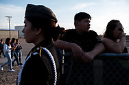 Abraham Duarte, 15, second from right, and his mother Daisy Duarte, 34, right, both of Horizon, attend a vigil for sophomore Javier Rodriguez, 15, at Horizon High School in Horizon, Texas, Monday, August 5, 2019. Duarte was a friend of Rodriguez, who was among the 23 people killed in the shooting at a Walmart on Aug. 3 in El Paso.