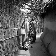 Vaccinators go house to house during vaccination day at a village on the flood plains of the Kosi river near Kusheshwar Asthan (E), Bihar.