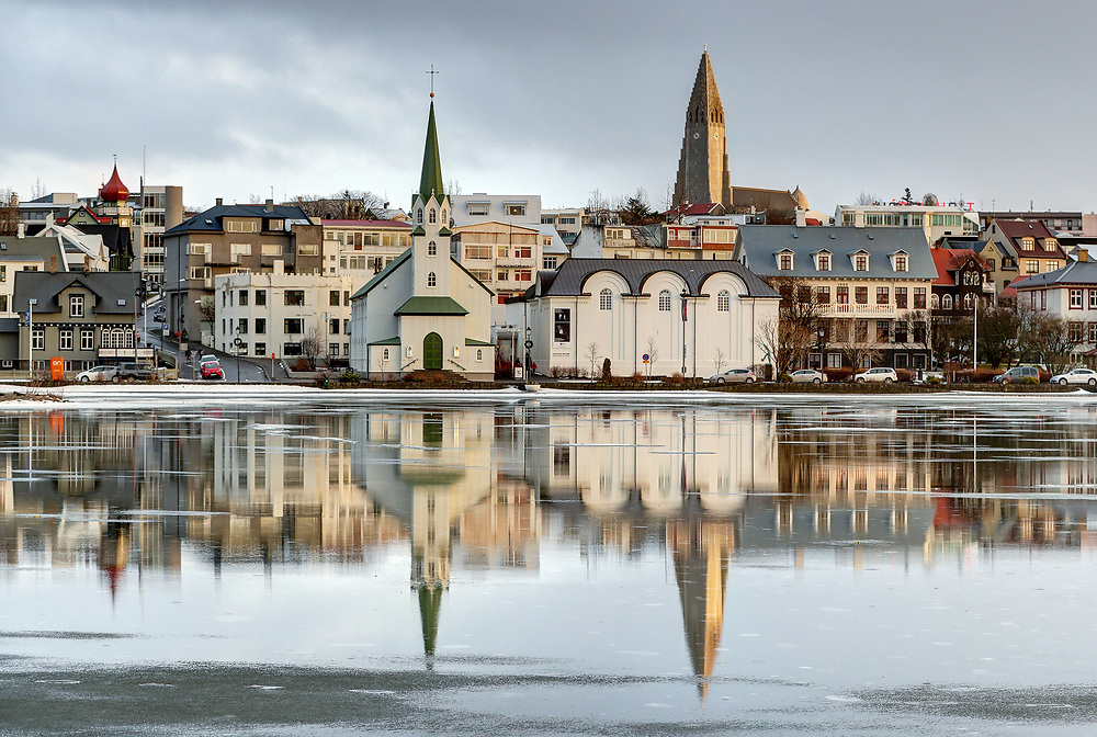 Buildings are reflected across Tjörnin lake located in downtown Reykjavík, the capital of Iceland.  Photo/Andrew Shurtleff Photography, LLC