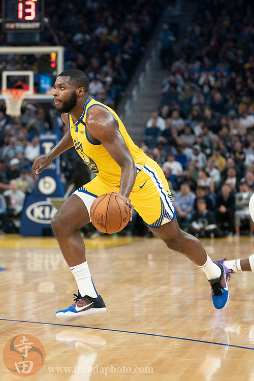 February 23, 2020; San Francisco, California, USA; Golden State Warriors forward Eric Paschall (7) dribbles the basketball during the second quarter against the New Orleans Pelicans at Chase Center.
