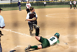 05 April 2008: Natalie Chase makes a sweeping slide past Jenny Burke to score. The Carthage College Lady Reds lost the first game of this double header to the Titans of Illinois Wesleyan 4-1 at Illinois Wesleyan in Bloomington, IL