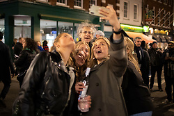 © Licensed to London News Pictures. 16/04/2021. London, UK. Brother of former Labour Party Leader Jeremy Corbyn and London mayoral candidate Piers Corbyn takes a selfie with a group of women in Soho in Central London. Earlier this week Lockdown restrictions were eased to allow non essential retail and outdoor dining to reopen. Photo credit: George Cracknell Wright/LNP