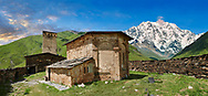 """The medieval Georgian Orthodox St George Church """"JGRag"""" with mount Shkhara (5193m) behind, Ushguli, Upper Svaneti, Samegrelo-Zemo Svaneti, Mestia, Georgia. At 2,200 m (7217 ft) above sea level in the Caucasus mountains St George Church is one of  the highest in Europe. Mount Shkhara is the highest mountain in the Caucasus range. .<br /> <br /> Visit our REPUBLIC of GEORGIA HISTORIC PLACES PHOTO COLLECTIONS for more photos to browse, download or buy as wall art prints https://funkystock.photoshelter.com/gallery-collection/Pictures-Images-of-Georgia-Country-Historic-Landmark-Places-Museum-Antiquities/C0000c1oD9eVkh9c"""