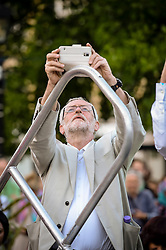 Labour leader Jeremy Corbyn takes a photograph during a Labour leadership hustings at College Green, Bristol.