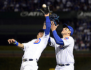 CHICAGO, IL - OCTOBER 22: Javier Baez #9 of the Chicago Cubs catches a pop-up hit by Josh Reddick in front of Anthony Rizzo #44 in the fourth inning during Game 6 of the NLCS against the Los Angeles Dodgers at Wrigley Field on Saturday, October 22, 2016 in Chicago, Illinois. (Photo by Ron Vesely/MLB Photos via Getty Images)    *** Local Caption *** Javier Baez; Anthony Rizzo