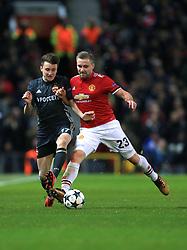 CSKA Moscow's Aleksandr Golovin (left) and Manchester United's Luke Shaw battle for the ball