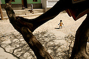 Some children play on the main street of Barranco Velho where there are some examples of simple popular architecture. As in most of Cape Verde archipelago, facades are colorfully painted.