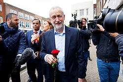 © Licensed to London News Pictures. 03/05/2017. London, UK. Leader of the Labour Party JEREMY CORBYN is given a bunch of roses by a member of public as he campaigns in Bedford town centre, Bedfordshire, UK, ahead of a general election on June 8, 2017. Photo credit: Tolga Akmen/LNP