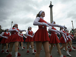 © London News Pictures. 01/01/2012. London, UK. Cheerleaders from Jacksonville State University, USA, march past Trafalgar Square while take part in the 2012 New Years Parade in London on January 1st, 2012. Photo credit : Ben Cawthra/LNP