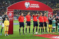 ROMANIA, Bucharest: Referee Jonas Eriksson (C) prepares for the Euro 2016 Group F qualifying football match Romania vs Northern Ireland in Bucharest, Romania on November 14, 2014.