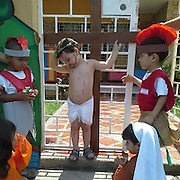 Photograph of school children acting out the crucifixion sparks outrage as picture goes viral<br /> <br /> An image of children play-acting the crucifixion of Jesus Christ at an unidentified school in Brazil for Holy Week complete with fake wounds and a crown of thorns has spread across the Internet.<br /> Wearing a loin cloth and a fake painted beard, the boy who acts as Jesus holds his two arms above his neck, to signify the last agonizing hours of Christ on the cross.<br /> Flecked across his body are red marks from his flogging at the hands of the Romans - played by two boys with mock-feathered galea helmets, who will presumably offer him fake vinegar and pretend to stab his side to ensure he has died at the culmination of the play.<br /> <br /> In the front of the picture are two young girls playing the role of Jesus' mother, Mary and follower Mary Magdalene, who according to the Bible tearfully witnessed his death on Calvary.<br /> The picture has been shared and liked some 230,000 times on Facebook and the reactions to the picture appear to vary from country to country.<br /> <br /> Commenters writing in English and Portuguese appear to dislike the imagery on show in the photograph , with many seemingly mocking children acting out a religious scene.<br /> One has posted the message, 'There seems to be no sign of intelligent life anywhere' in response to the image.<br /> <br /> Others have made the point that the crucifixion and death of Jesus Christ and its message may be difficult for children to understand.<br /> Some have claimed that the exposure of children to the story is akin to manipulation - despite Brazil's status as the world's most populus Catholic country.<br /> However, most messages on the Facebook page are in praise of the image - with the majority standing up for the right of the school and children to depict the scene.<br /> One woman, Carlos Ferreira calls the criticism 'ridiculous', emphasizing the importance of the young learning 'the mea