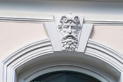 Architectural details on the facade of a building in the historic 2nd district of Vienna, Austria