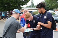 AFC Wimbledon midfielder Alfie Eagan (28) signing autographsduring the Pre-Season Friendly match between AFC Wimbledon and Queens Park Rangers at the Cherry Red Records Stadium, Kingston, England on 14 July 2018. Picture by Matthew Redman.