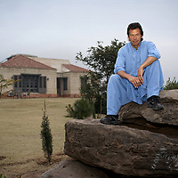 Imran Khan in the grounds of his house which sits on a hill overlooking Islamabad.<br />