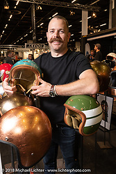 Ben Saggers working the Hedon helmet display in the Intermot Customized hall at the Intermot International Motorcycle Fair. Cologne, Germany. Friday October 5, 2018. Photography ©2018 Michael Lichter.