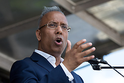 © Licensed to London News Pictures. 09/08/2014. London, UK. Mayor of Tower Hamlets, Lutfur Rahman speaks to protesters who stage a national demonstration against Israeli military action in Gaza, marching from BBC Broadcasting House to Hyde Park, via Oxford Street and the US Embassy in central London on 9th August 2014. Photo credit : Vickie Flores/LNP
