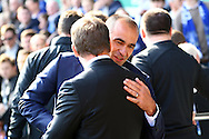 Everton Manager Roberto Martinez and Liverpool Manager Brendan Rogers shake hands prior to kick off. Barclays Premier League match, Everton v Liverpool at Goodison Park in Liverpool on Sunday 4th October 2015.<br /> pic by Chris Stading, Andrew Orchard sports photography.