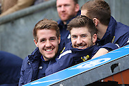 Scott Wootton of Leeds United (l) and teammate Luke Murphy look on from the bench prior to kick off. Skybet football league Championship match, Blackburn Rovers v Leeds United at Ewood Park in Blackburn, Lancs on Saturday 12th March 2016.<br /> pic by Chris Stading, Andrew Orchard sports photography.