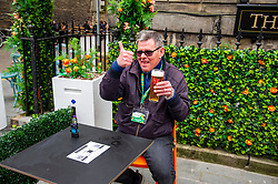 The Covid 19 lockdown in Scotland has been eased and purveyors of refreshments are happy to see customers return. John Shaw is keen for a complete relaxation of restriction so he does not have to wear his card explaining why he is not wearing a mask