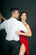 Couple dances tango On Black Background