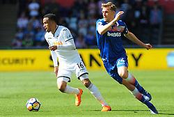 Martin Olsson of Swansea City gets past Darren Fletcher of Stoke City -Mandatory by-line: Nizaam Jones/JMP- 13/05/2018 - FOOTBALL - Liberty Stadium - Swansea, Wales - Swansea City v Stoke City - Premier League