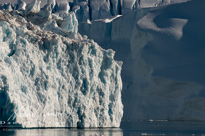 Chunks of the Ilulissat Kangerlua glacier, the worlds most prolific glacier outside of Antarctica clutter the Jakobshavn Icefjord near the town of Ilulissat, Greenland