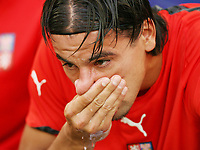 Photo: Chris Ratcliffe.<br /> USA v Czech Republic. Group E, FIFA World Cup 2006. 12/06/2006.<br /> Milan Baros of the Czech Republic crys on the bench before the game.