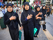 03 NOVEMBER 2014 - YANGON, MYANMAR: Shia Muslim women in Yangon walk through the streets beating their chests during the celebration of Ashura. Shia Muslims in Yangon started the celebration of Ashura Monday. Ashura commemorates the death of Hussein ibn Ali, the grandson of the Prophet Muhammed, in the 7th century. Hussein ibn Ali is considered by Shia Muslims to be the third Imam and the rightful successor of Muhammed. He was killed at the Battle of Karbala in 610 CE on the 10th day of Muharram, the first month of the Islamic calendar. According to Myanmar government statistics, only about 4% of Myanmar is Muslim. Many Muslims have fled Myanmar in recent years because of violence directed against Burmese Muslims by Buddhist nationalists.    PHOTO BY JACK KURTZ