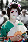 Geisha at a traditional temple festival. Sanja Matsur (Three Shrine Festival), is an annual Shinto festival held in Tokyo. The earliest form of the festivals dates back to the 7th century CE and is held in honor of Hinokuma Hamanari, Hinokuma Takenari and Hajino Nakatomo, the three men who established and founded Sensō-ji temple. Sanja Matsuri is held on the third weekend of every May at Asakusa Shrine. Its  parades revolve around three mikoshi (three portable shrines referenced in the festival's name), as well as traditional music and dancing.