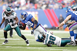 New York Giants running back Danny Ware #28 is tackled during the NFL Game between the Philadelphia Eagles and the New York Giants.  The Eagles won 38-31 at The New Meadowlands Stadium in East Rutherford, New Jersey on Sunday December 19th 2010. (Photo By Brian Garfinkel)